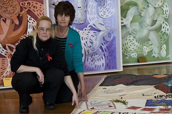 Nicki with the panel she made for her brother Robin while it was on display at Te Papa Tongarewa, the Museum of New Zealand, on the day The Quilt was formally welcomed to Te Papa, its new home. On her left with her is her daughter Megan.